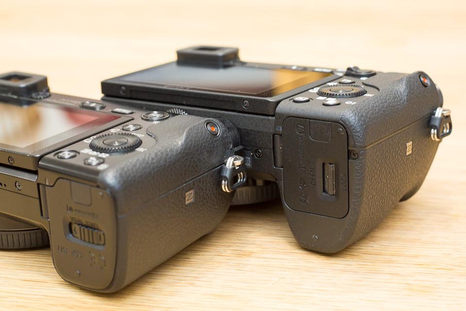 バッテリー&SDカード用のフタの形状が変わった。中のバッテリーロックレバーも形や位置が変わっている